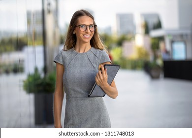 Businesswoman headshot of corporate executive assistant, portrait, outside in business district