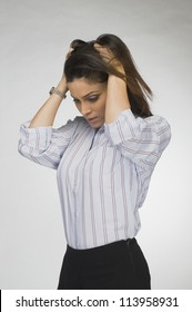 Businesswoman with her hands in her hair