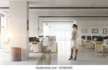 Businesswoman in her office . Mixed media