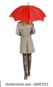 businesswoman with her raincoat and umbrella going to work