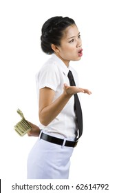 businesswoman hiding money behind her back, isolated on white background