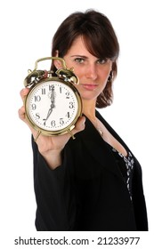 Businesswoman holding an alarm clock with selective focus