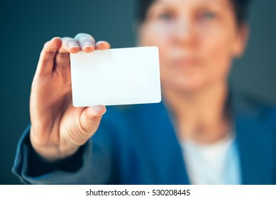 Businesswoman holding blank business card as copy space for text or career motivational message