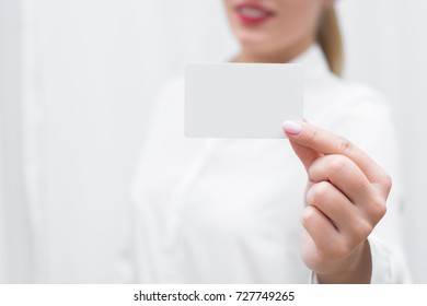 Businesswoman holding business card. We are hiring concept.