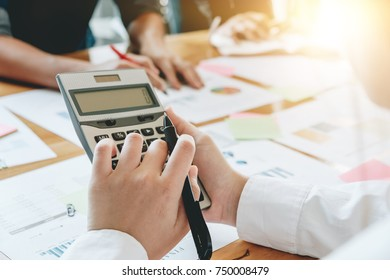 Businesswoman holding calculator for calculate financial data at meeting room, Business Financing Accounting Banking Concept