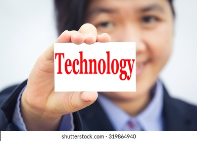 Businesswoman holding card with Technology message.