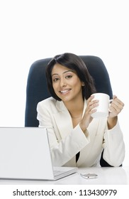 Businesswoman holding a coffee mug and smiling
