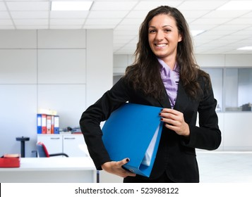 Businesswoman holding a document binder