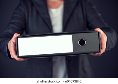 Businesswoman holding document ring binder with blank label as copy space, female accountant or financial advisor archiving business documentation