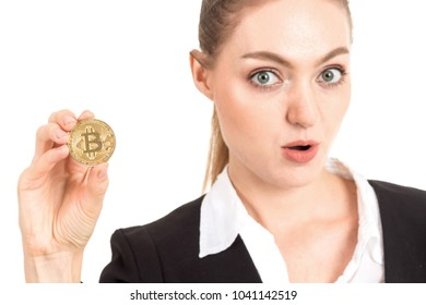 Businesswoman holding golden bitcoin in her hand isolated on white background