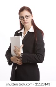 Businesswoman holding laptop computer and looking unhappy