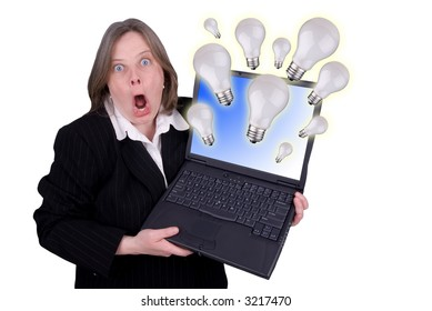 Businesswoman holding a laptop with light-bulbs flying out with a shocked expression isolated over white