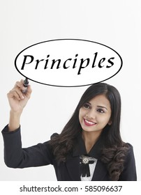 businesswoman holding a marker pen writing -principles