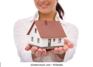 businesswoman holding a mini house for real estate concept