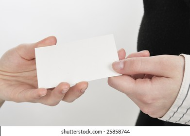 Businesswoman holding out a blank business card. Room for text, or your own message.