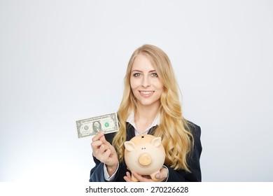Businesswoman Holding Piggy Bank with an one dollar bill.