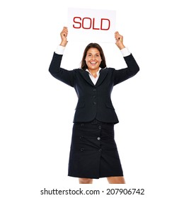 Businesswoman holding sold sign. Isolated on a withe background.