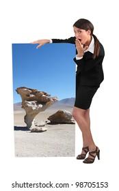 businesswoman holding a strange poster