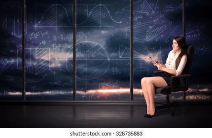Businesswoman holding tablet in office room with graph charts on window concept