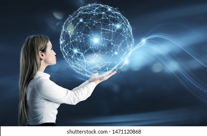 Businesswoman holds an abstract world with internet connection network effect