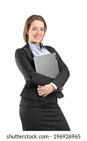 Businesswoman hugging a laptop isolated on white background