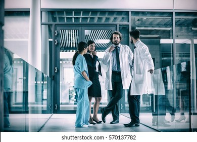 Businesswoman interacting with doctors in hospital