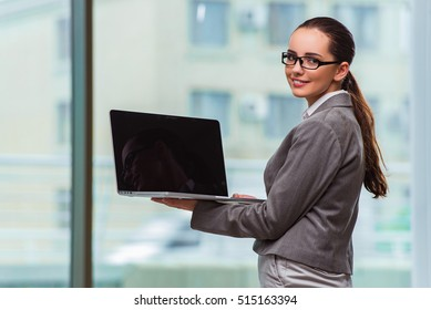 Businesswoman with laptop in business concept
