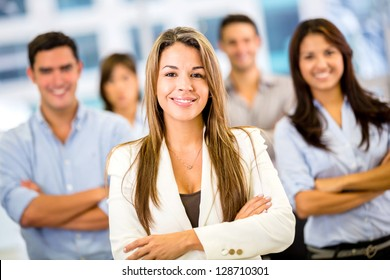 Businesswoman leading a business group and looking happy