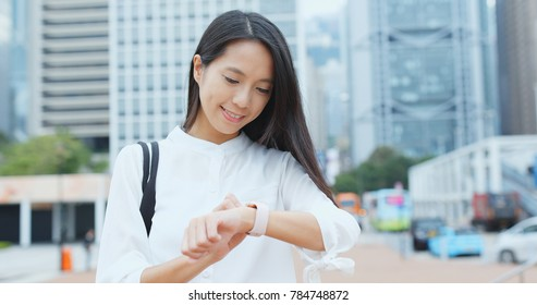 Businesswoman look at the smart watch