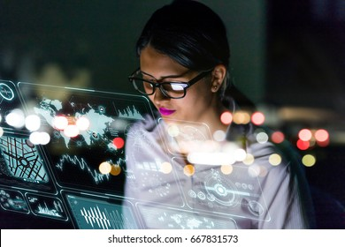 businesswoman looking at futuristic interface screen.
