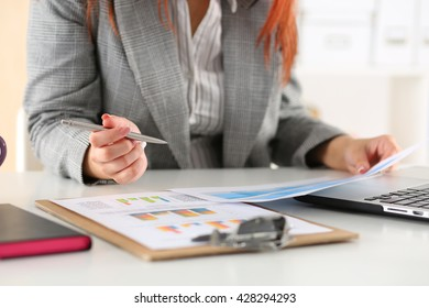 Businesswoman looking at graphics. Manager or auditor reading reports. Financial planning, business analysis and project management concept.