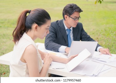 Businesswoman looking at tablet in her hands, business concept