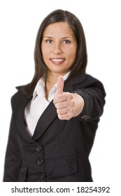 Businesswoman making a characteristic thumb-up gesture - selective focus on the hand.