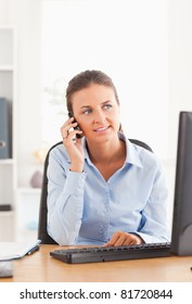 Businesswoman making a phone call in her office