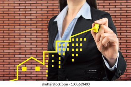 businesswoman is making a positive trend in investment real estate concept with black background. All screen content is designed by me and not copyrighted by others and created with pen tablet and ps