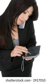 Businesswoman making a telephone call - using wireless office devices
