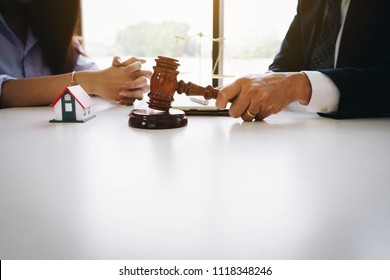 Businesswoman and male lawyers having a meeting at a law firm. Home loan insurance, lawyer or judge Law and justice concept. Real Estate Law concept
