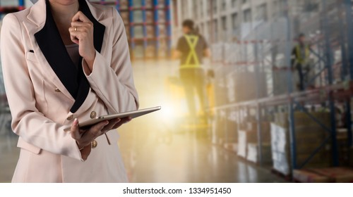 Businesswoman manager using tablet check and control for workers with Modern Trade warehouse logistics. Industry 4.0 concept