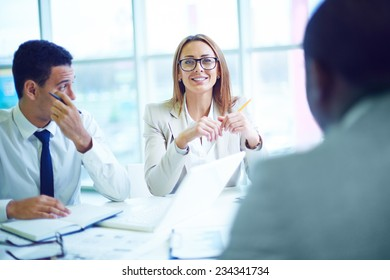 Businesswoman at meeting with men