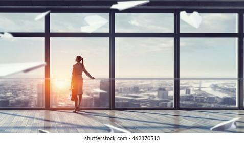 Businesswoman in modern office interior . Mixed media