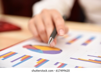 Businesswoman Monitoring Stock Statistics And  Financial Report. Close Up
