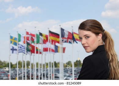 Businesswoman next to flags