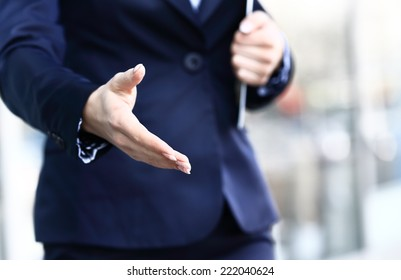 Businesswoman offer hand to handshake