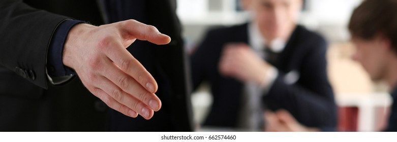 Businesswoman offer hand to shake as hello in office closeup. Serious business, friendly support service, excellent prospect, introduction or thanks gesture, gratitude, invite to participate concept