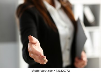 Businesswoman offer hand to shake as hello in office closeup.  invite to participate concept