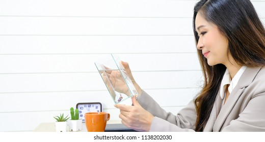 Businesswoman in office  with beautiful fish in a dozen glasses.