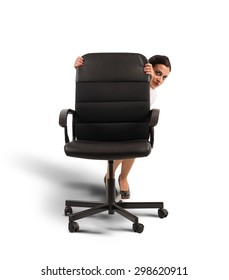 Businesswoman in the office behind a chair