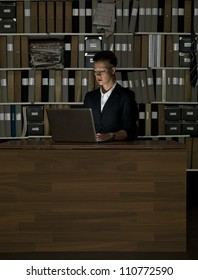 Businesswoman at the office by night