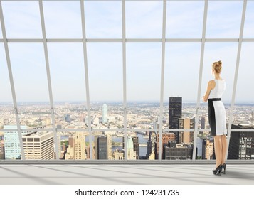 businesswoman in office and city views