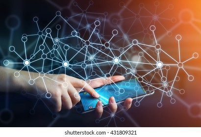 Businesswoman in office using digital data network with his mobile phone